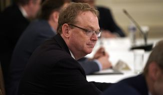 White House senior adviser Kevin Hassett arrives for a meeting between President Donald Trump and Republican lawmakers, in the State Dining Room of the White House, Friday, May 8, 2020, in Washington. (AP Photo/Evan Vucci)