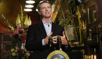 Gov. Gavin Newsom discusses the reopening of businesses during a news conference at Twiggs Floral Design Gallery in Sacramento, Calif., Friday, May 8, 2020. Newsom spoke about his administration's guidance allowing retailers, including flower shops, to begin opening Friday with restrictions like curbside pickup. (AP Photo/Rich Pedroncelli, Pool)