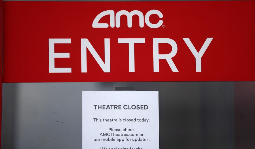 A closed sign is displayed on an AMC Theatre in Clinton Township, Mich., Friday, May 8, 2020. All AMC theatres are temporarily closed due to the coronavirus pandemic. (AP Photo/Paul Sancya)