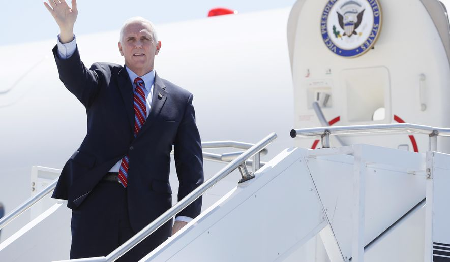 Vice President Mike Pence waves as he stops off Air Force Two after arriving at the Des Moines International Airport before meeting with faith leaders and food industry executives in response to the coronavirus pandemic, Friday, May 8, 2020, in Des Moines, Iowa. (AP Photo/Charlie Neibergall) **FILE**