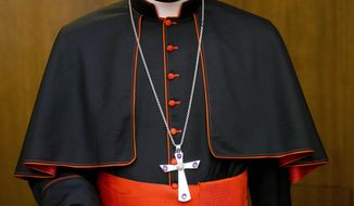 In this Oct. 14, 2015 photo, Cardinal Robert Sarah, prefect of the Congregation for Divine Worship and the Discipline of the Sacraments, arrives for the presentation of Cardinal Raymond Leo Burke's book Divine Love Made Flesh, in Rome. Cardinal Sarah, the highest ranking signatory of a petition signed by some conservative Catholics claiming the coronavirus is an overhyped pretext to deprive the faithful of Mass and impose a new world order, and which has run into a bit of a hitch, claims he never signed the petition. But archbishop Carlo Maria Vigano, who spearheaded the initiative, said Friday, May 8, 2020 that Sarah was fully on board with it, and has the recorded phone conversations to prove it. (AP Photo/Andrew Medichini)