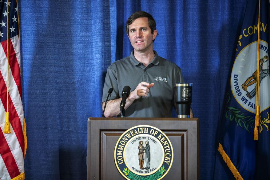In this Sunday, May 3, 2020, file photo, Kentucky Gov. Andy Beshear speaks during a news conference at the state's Emergency Operations Center at the Boone National Guard Center in Frankfort, Ky., about the coronavirus pandemic.  (Ryan C. Hermens/Lexington Herald-Leader via AP) **FILE**