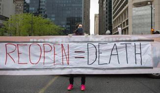 """Counter protestors with """"Refuse Fascism"""" block off Market Street as demonstrators in support of """"Open Up Philly"""" circle City Hall in their cars Friday, May 8, 2020, in Philadelphia, Pa.  (Joe Lamberti/Camden Courier-Post via AP) ** FILE **"""
