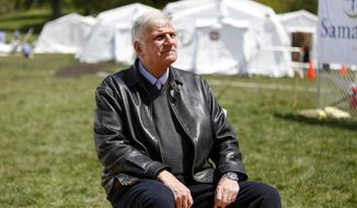 In this May 7, 2020, photo, the Rev. Franklin Graham, president and CEO of Samaritan's Purse, sits for a portrait at his group's field hospital in New York's Central Park. The Christian relief charity is set to conclude its coronavirus efforts at the end of next week. (AP Photo/Jessie Wardarski)