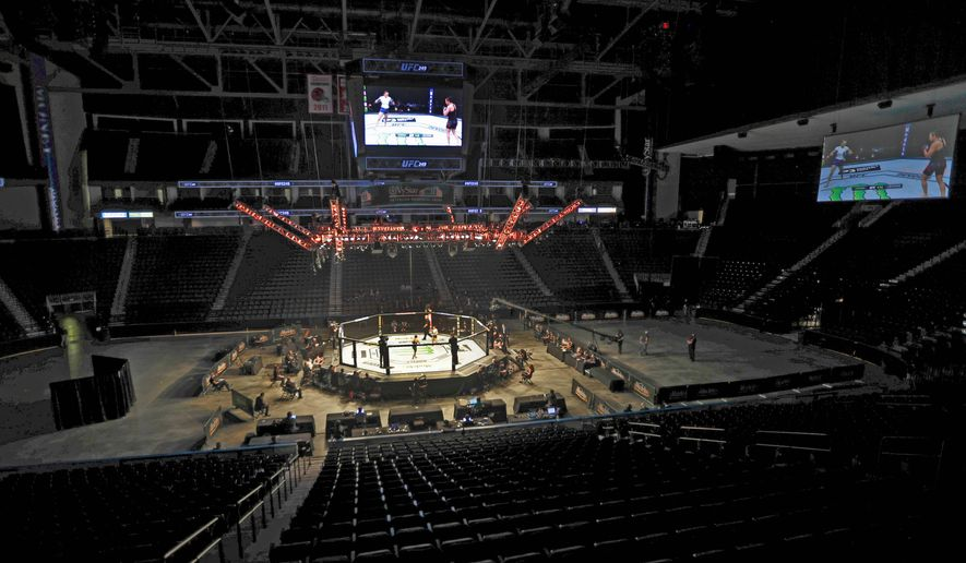 Fighters battle without fans during a UFC 249 bout Saturday in Jacksonville, Florida. UFC added new protocols to be the first major U.S. sporting event since the shutdown began. (ASSOCIATED PRESS)
