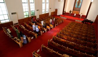 Using social distancing practices, churchgoers return to in-person services at Alamo Heights Baptist Church, Sunday, May 10, 2020, in San Antonio. Texas' stay-at-home orders due to the COVID-19 pandemic have expired and Texas Gov. Greg Abbott has eased restrictions on many businesses, state parks, churches and places of worship. (AP Photo/Eric Gay)
