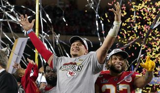 FILE - In this Feb. 2, 2020, file photo, Kansas City Chiefs' Patrick Mahomes, left, and Tyrann Mathieu celebrate after defeating the San Francisco 49ers in the NFL Super Bowl 54 football game in Miami Gardens, Fla. The Kansas City Chiefs began talking about a repeat before they had even left the stadium following their Super Bowl triumph. (AP Photo/David J. Phillip, File)