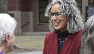 FILE - In this April 5, 2019 file photo former state Rep. Kathleen Williams, right, smiles to a supporter after announcing her candidacy for Montana's U.S. House seat at a rally in Billings, Mont. Williams, a Democrat, lost a bid for the seat in 2018 and is making another run this year after U.S. Rep. Greg Gianforte did not seek re-election. Women candidates are positioned to make significant gains in Montana's election this year with the highest number seeking statewide political office in at least two decades, including races for governor, U.S. House and other high-profile posts. (AP Photo/Matthew Brown,File)