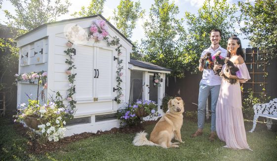 Chris and Brianne Whelan pose next to their new chicken coop with their silkie chickens and Royal Rooster the dog at their home in New Orleans, Monday, May 4, 2020. In the months since her first silkie eggs arrived, Brianne has learned that she is good at hatching and rearing chicks. ( Sophia Germer/The Advocate via AP)