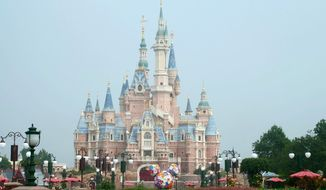 The Disneyland theme park is seen in Shanghai as the theme park reopened, Monday, May 11, 2020. Visits will be limited initially and must be booked in advance, and the company said it will increase cleaning and require social distancing in lines for the various attractions. With warmer weather and new coronavirus cases and deaths falling to near-zero, China has been reopening tourist sites such as the Great Wall and the Forbidden City palace complex in Beijing.(AP Photo/Sam McNeil)