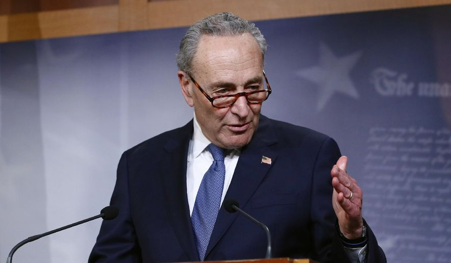 In this April 21, 2020, file photo, Senate Minority Leader Sen. Chuck Schumer of N.Y., speaks with reporters on Capitol Hill in Washington. (AP Photo/Patrick Semansky) ** FILE **