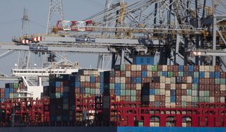 In this Monday, March 23, 2020 file photo, shipping containers are offloaded from a vessel in the Port of Antwerp, Belgium. They can't expect much sympathy, but lockdowns and travel restrictions mean small-time drug dealers can't do business as usual during the coronavirus pandemic. Street sellers in Brussels and Paris have changed their work hours and delivery methods due to the end of public nightlife and a drop in demand. (AP Photo/Virginia Mayo, File)