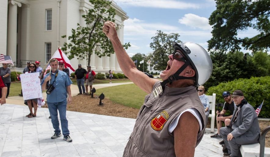 """Ken Barnett chants with other protesters as they gather for a """"Stop the Shutdown"""" demonstration on the steps of the Alabama State Capitol in Montgomery, Ala., Tuesday, May 5, 2020. About 60 people attended the rally to express frustration with the continuing state-ordered closures of businesses that had previously been categorized as nonessential, such as hair salons and gyms. (Jake Crandall/The Montgomery Advertiser via AP)"""