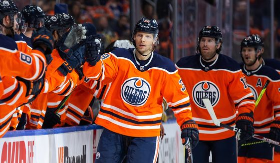 FILE - In this March 9, 2020, file photo, Edmonton Oilers' Alex Chiasson (39) celebrates his goal against the Vegas Golden Knights during the first-period of an NHL hockey game game in Edmonton, Alberta. Making it safe for America's professional sports teams to start playing games is one thing. Making sure athletes are in game shape is another. Experts say nothing should be rushed. Athletes in the NBA, NHL and Major League Baseball all indicate that a few weeks of training is necessary before any games. (Codie McLachlan/The Canadian Press via AP, File)