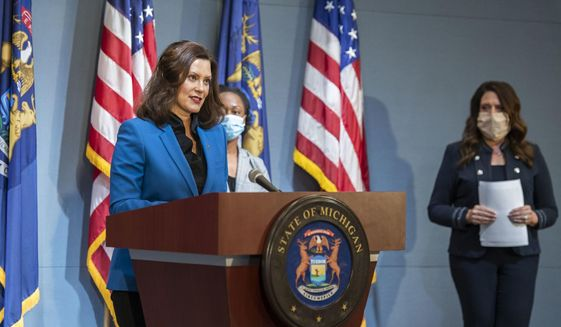 In a pool photo provided by the Michigan Office of the Governor, Michigan Gov. Gretchen Whitmer addresses the state during a speech in Lansing, Mich., Monday, May 11, 2020. Protests against Whitmer have erupted in recent weeks as she has put in place restrictions on businesses and Michigan residents, including a sweeping stay-at-home order, intending to limit gatherings as a way to reduce the spread of coronavirus. (Michigan Office of the Governor via AP, Pool)