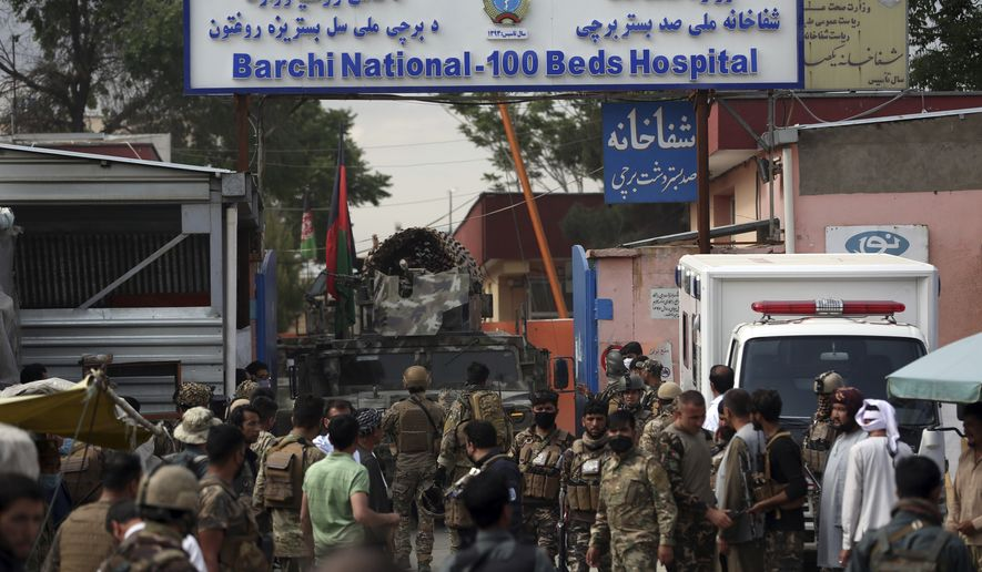 Afghan security officers stand in front of a maternity hospital, in Kabul, Afghanistan, Tuesday, May 12, 2020. Militants stormed a maternity hospital in the western part of Kabul on Tuesday, setting off an hours-long shootout with the police and killing over a dozen people, including two newborn babies, their mothers and an unspecified number of nurses (AP Photo/Rahmat Gul)