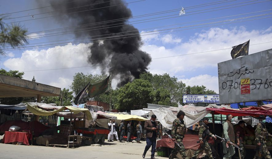 Smokes rises from a maternity hospital, after gunmen attacked in Kabul, Afghanistan, Tuesday, May 12, 2020. Gunmen stormed the hospital in the western part of Kabul on Tuesday, setting off a shootout with the police and killing several people. (AP Photo/Rahmat Gul)