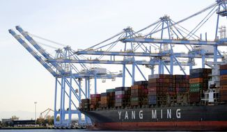 FILE - In this Nov. 4, 2019, file photo cargo cranes are used to take containers off of a Yang Ming Marine Transport Corporation boat at the Port of Tacoma in Tacoma, Wash. China has suspended punitive tariffs on more U.S. goods including radar equipment for aviation amid pressure from President Donald Trump to buy more imports as part of a truce in their trade war. (AP Photo/Ted S. Warren, File)