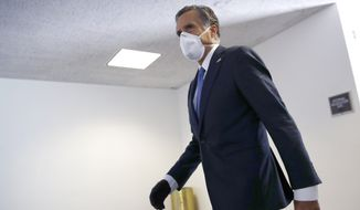Sen. Mitt Romney, R-Utah, wears a face mask to protect against the spread of the new coronavirus on Capitol Hill in Washington, Tuesday, May 12, 2020. (AP Photo/Patrick Semansky)