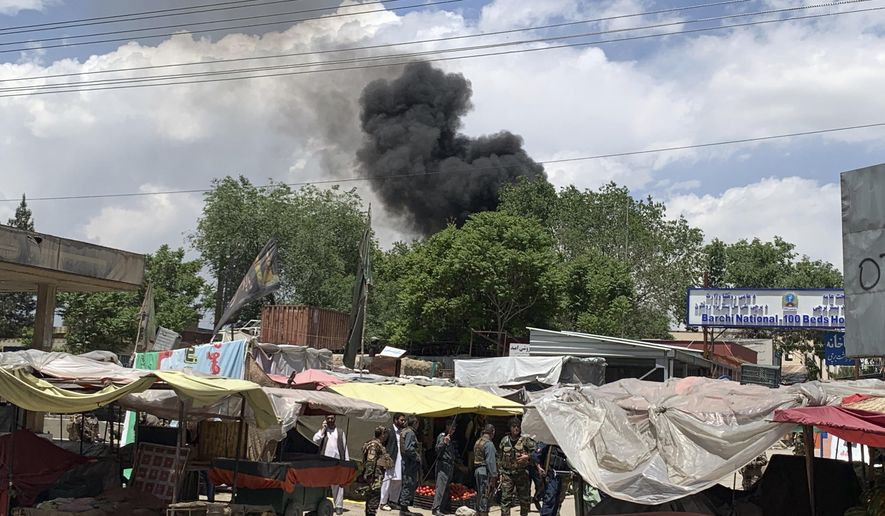 Smokes rises from a hospital after gunmen attacked in Kabul, Afghanistan, Tuesday, May 12, 2020. Gunmen stormed the hospital in the western part of the Afghan capital on Tuesday, setting off a gun battle with the police, officials said. (AP Photo/Rahmat Gul)
