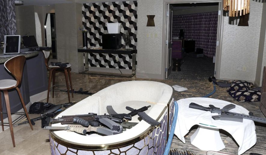 This October 2017 file photo released by the Las Vegas Metropolitan Police Department Force Investigation Team Report shows the interior of Stephen Paddock's 32nd-floor room of the Mandalay Bay hotel in Las Vegas after a mass shooting. A federal judge wants Nevada's highest court to tell him whether gun manufacturers and sellers can be held liable under state law for negligence and wrongful death in the case of a Seattle woman killed in the Las Vegas Strip mass shooting in 2017. (Las Vegas Metropolitan Police Department via AP, File)