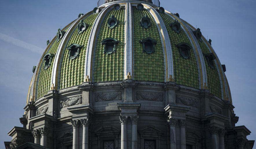 In this Feb. 5, 2019, file photo, the dome caps the Pennsylvania Capitol in Harrisburg, Pa. (AP Photo/Matt Rourke, File)