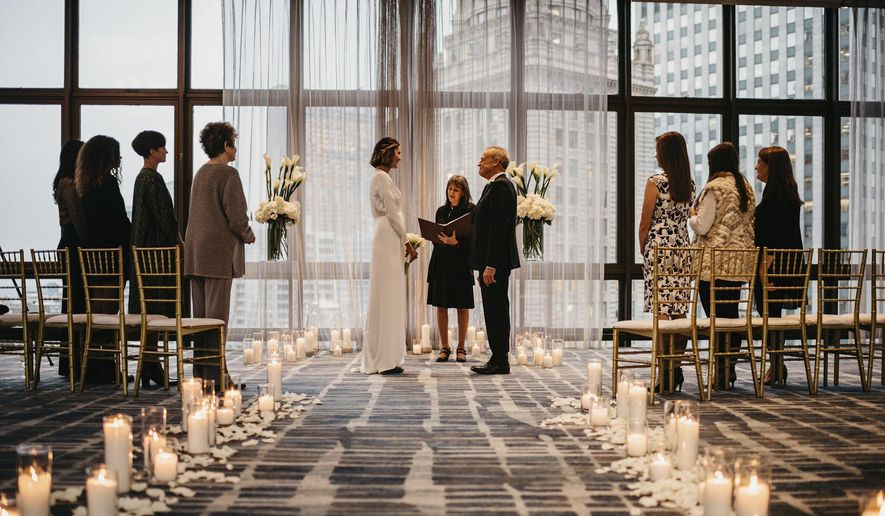 This photo released by Erin Elliott shows the wedding of Melissa Todd and Jeffrey Hall in November 2019 in Chicago. The couple had seven guests, feeding a trend toward micro weddings that has grown stronger since the coronavirus pandemic sent millions into isolation. (Erin Elliott via AP)