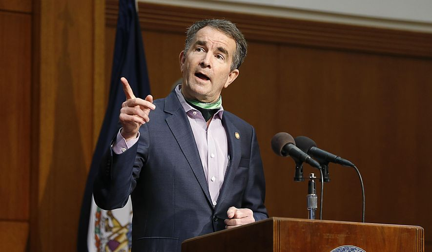 Virginia Gov. Ralph Northam speaks during the COVID-19 update news conference in the Patrick Henry Building Friday May 8, 2020 in Richmond, Va. (Mark Gormus/Richmond Times-Dispatch via AP) ** FILE **