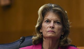 Sen. Lisa Murkowski, R-Alaska, listens to testimony by Dr. Anthony Fauci, director of the National Institute of Allergy and Infectious Diseases, before the Senate Committee for Health, Education, Labor, and Pensions hearing, Tuesday, May 12, 2020, on Capitol Hill in Washington. (Toni L. Sandys/The Washington Post via AP, Pool) ** FILE **