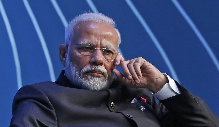 FILE - In this Wednesday, Nov. 13, 2019, file photo, Indian Prime Minister Narendra Modi attends the BRICS Business Council prior to the 11th edition of the BRICS Summit, in Brasilia, Brazil. Modi announced Tuesday, May 12, 2020, that the government will spend the equivalent of nearly 10% of the country's GDP on a coronavirus virus economic relief package designed to make the world's second most populous nation more self reliant. (AP Photo/Eraldo Peres, File)