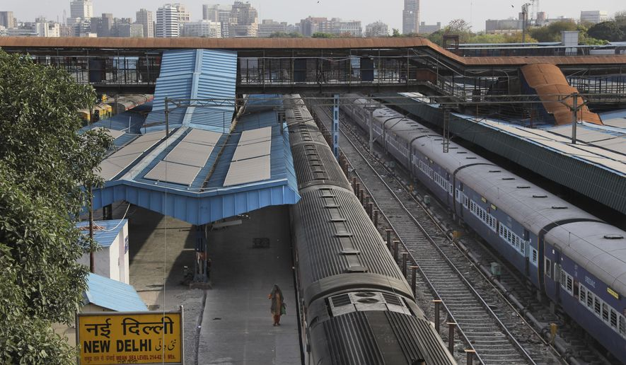 This March 23, 2020, photo shows a deserted New Delhi railway station during lockdown in India. India is set to re-open some parts of its colossal rail network on Tuesday, as the country looks at easing its nearly seven-week strict lockdown amid an increase in coronavirus infections.  (AP Photo/Manish Swarup)
