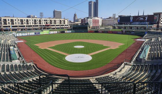 In this April 8, 2020, file photo, an empty Parkview Field minor league baseball stadium is shown in downtown Fort Wayne, Ind. Unlike the NFL, NBA or Major League Baseball that can run on television revenue, it's impossible for some minor sports leagues in North America to go on in empty stadiums and arenas in light of the coronavirus pandemic. These attendance-driven leagues might not play again at all in 2020, putting some teams in danger of surviving at all and potentially changing the landscape of minor league sports in the future. (Mike Moore/The Journal-Gazette via AP) ** FILE **