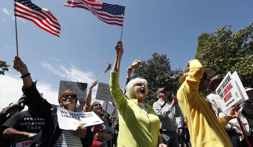 People gather outside the executive mansion to protest stay-at-home orders due to COVID-19 during a ReOpen NC rally in Raleigh, N.C., Tuesday, May 12, 2020. (AP Photo/Gerry Broome) **FILE**