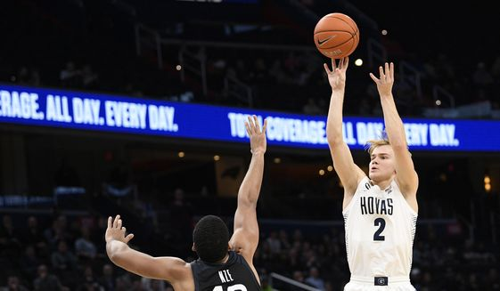 In this Tuesday, Jan. 28, 2020, file photo, Georgetown guard Mac McClung (2) shoots as he is defended by Butler forward Bryce Nze (10) during the second half of an NCAA college basketball game, in Washington. McClung announced Wednesday, May 13, 2020, that he plans to enter the NCAA transfer portal so he can switch schools after taking his name out of consideration for the NBA draft. (AP Photo/Nick Wass, File)  **FILE**