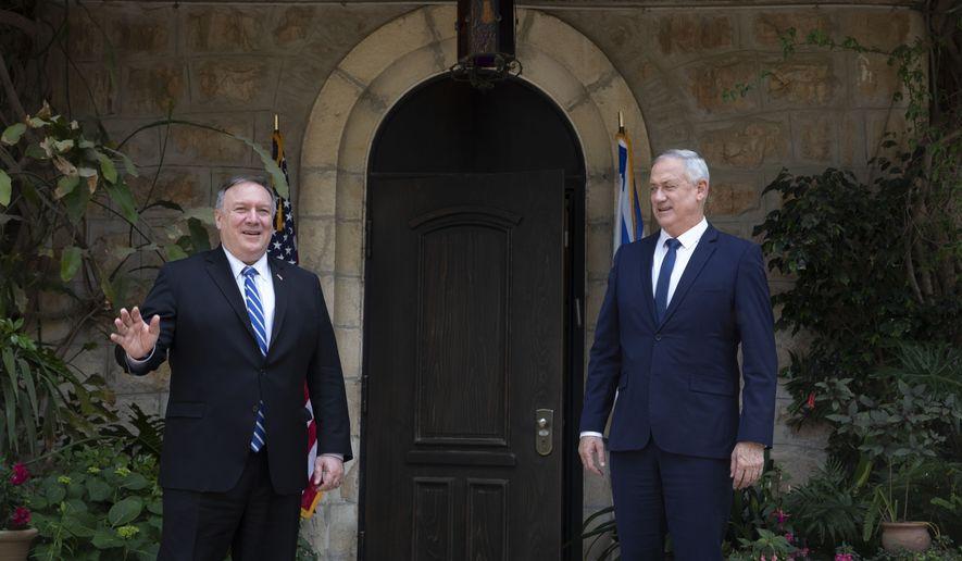 U.S. Secretary of State Mike Pompeo, left, meets Israeli Blue and White party leader Benny Gantz in Jerusalem, Wednesday, May 13, 2020. (AP Photo/Sebastian Scheiner, Pool)