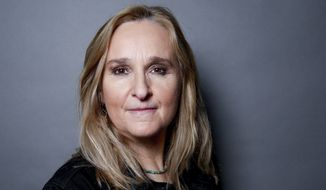 In this April 12, 2016, file photo, Melissa Etheridge poses for a portrait in Hidden Hills, Calif. Etheridge's 21-year-old son Beckett Cypher has died. The death was announced Wednesday on the singer-songwriter's Twitter account. (Photo by Rich Fury/Invision/AP, File)