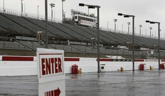 In this Sept. 2, 2016, file photo, empty grandstands are shown at Darlington Raceway after bad weather forced NSACAR to call off Friday, Sept. 2, 2016, in Darlington, S.C. Bad weather forced NASCAR to call off qualifying for the Sprint Cup and XFinity series auto races. NASCAR will have a much different feel when it resumes this weekend as the two-man broadcast team for Fox will not travel to Darlington Raceway and instead call the race from a studio in Charlotte.(AP Photo/Terry Renna, File)  **FILE**