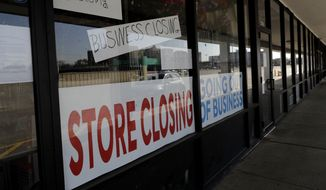 A sign announces a store closing in Niles, Ill., Wednesday, May 13, 2020. (AP Photo/Nam Y. Huh)