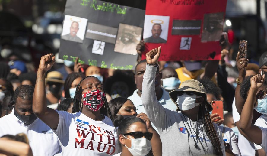 """REMOVES """"UNARMED"""" AND ADDS THAT AUTHORITIES HAVE NOT CONFIRMED THAT ARBERY WAS EITHER ARMED OR UNARMED - People react during a rally to protest the shooting of Ahmaud Arbery, Friday, May 8, 2020, in Brunswick Ga. Two men have been charged with murder in the February shooting death of Arbery, a black man in his mid-20s, whom they had pursued in a truck after spotting him running in their neighborhood. (AP Photo/John Bazemore)"""