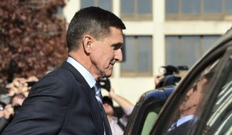 In this Dec. 1, 2017, file photo, former President Donald Trump national security adviser Michael Flynn leaves federal court in Washington. Newly released FBI documents show the FBI concluded Mr. Flynn believed he was telling the truth at the time of his interviews with bureau agents. (AP Photo/Susan Walsh, File)