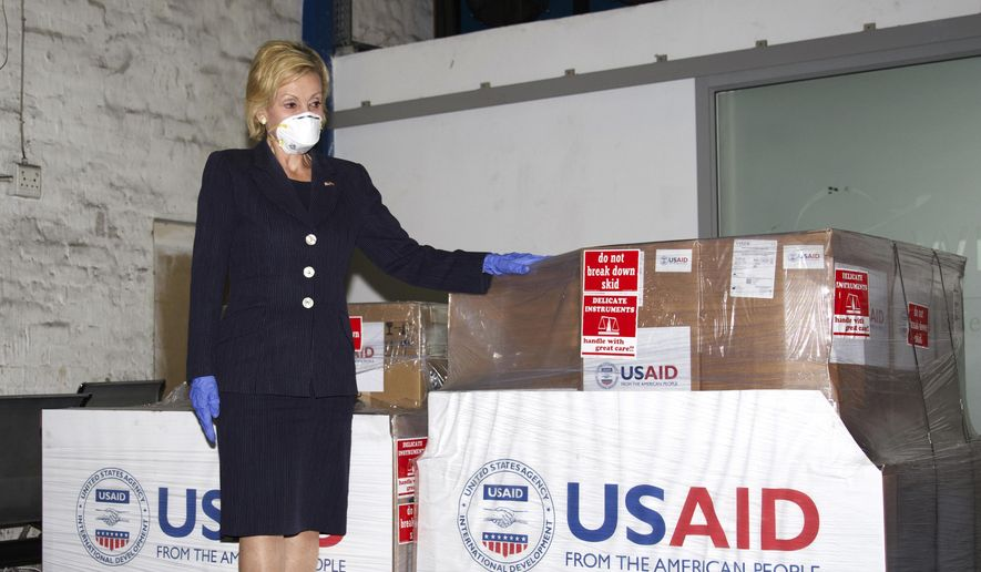 This file photo taken Monday. May 11, 2020, at OR Tambo Airport Johannesburg and supplied by the United States Embassy in Pretoria, South Africa shows U.S. Ambassador to South Africa Lana Marks posing with ventilators donated by the U.S. Government. The United States is donating up to 1,000 ventilators to assist with South Africa's national response to COVID-19. (Photo/Leon Kgoedi, United States Embassy South Africa via AP) ** FILE **