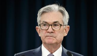 In this March 3, 2020, photo, Federal Reserve Chair Jerome Powell pauses during a news conference in Washington. (AP Photo/Jacquelyn Martin) **FILE**
