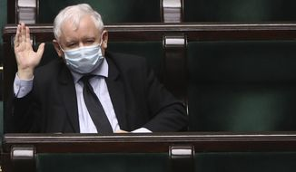 Poland's main ruling party leader Jaroslaw Kaczynski, wears a mask for protection against the coronavirus in parliament during work on new legislation that is to ensure the health and safety of the postponed presidential election to be held this summer, in Warsaw, Poland, Tuesday, May 12, 2020. (AP Photo/Czarek Sokolowski)