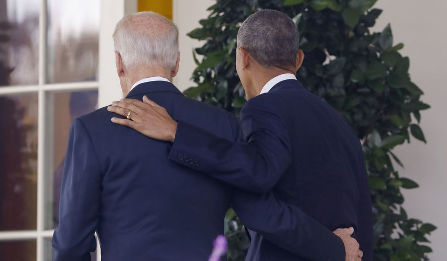 In this Nov. 9, 2016, file photo, President Barack Obama and Vice President Joe Biden, with their arms on each other, walk back to the Oval Office of the White House in Washington, after the president spoke about the election in the Rose Garden. Nearly eight years after he was last on the ballot, Obama is emerging as a central figure in the 2020 presidential election. Democrats are eagerly embracing Obama as a political wingman for Joe Biden, who spent two terms by his side as vice president. Obama remains the party's most popular figure, particularly with black voters and younger Democrats. (AP Photo/Pablo Martinez Monsivais, File)
