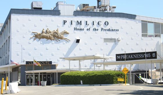 The Preakness Stakes, the Triple Crown horse race held every year at Pimlico Race Course in Baltimore, will not be held on time in 2020 due to the coronavirus pandemic. The course's parking lot is serving as a COVID-19 drive-thru testing site. The exterior of Pimlico's stands is seen here on Wednesday, May 13, 2020. (Photo by Adam Zielonka / The Washington Times)