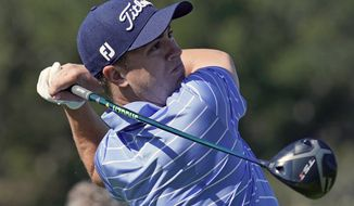 """In this Feb. 12, 2020, file photo, Justin Thomas hits his tee shot on the 17th hole during the Genesis Invitational pro-am golf event at Riviera Country Club in the Pacific Palisades area of Los Angeles. Justin Thomas can put down the driver and grab a controller: The former PGA Championship winner made the cover of the """"PGA Tour 2K21"""" video game. (AP Photo/Ryan Kang) ** FILE **"""