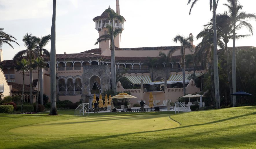 This Nov. 24, 2017, file photo shows President Donald Trump's Mar-a-Lago resort in Palm Beach, Fla. President Trump's Mar-a-Lago club will partially reopen to members this weekend as South Florida slowly reopens from the coronavirus lockdown. An email sent Thursday, May 14, 2020, to members says the Palm Beach resort's Beach Club restaurant, its pool and its whirlpool will reopen Saturday after being closed two months, but its main building that includes hotel rooms, the main dining area and the president's private residence will remain closed. (AP Photo/Alex Brandon, File)