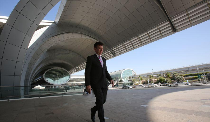 In this June 17, 2014, file photo, Dubai Airports CEO Paul Griffiths walks out of Dubai International Airport's Terminal 3 in Dubai, United Arab Emirates. (AP Photo/Kamran Jebreili, File)