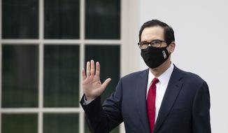 Treasury Secretary Steven Mnuchin wears a mask as he walks on the grounds of the White House, Thursday, May 14, 2020, in Washington. (AP Photo/Alex Brandon)