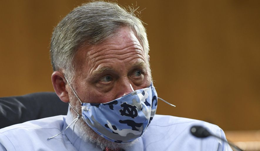 Sen. Richard Burr, R-N.C., listens to testimony before the Senate Committee for Health, Education, Labor, and Pensions hearing, Tuesday, May 12, 2020, on Capitol Hill in Washington. (Toni L. Sandys/The Washington Post via AP, Pool)